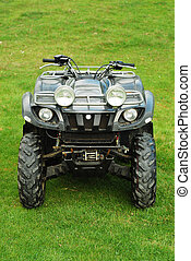 all terrain vehicle - atv in the grass