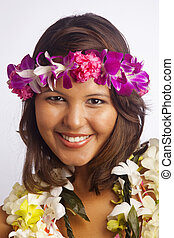 girl with flower lei and fruit - portrait of a Hawaiian girl...