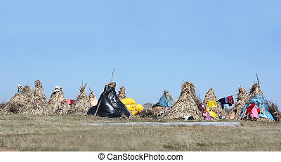 Nomad Huts - Nomad huts settlement in the Indian grasslands.