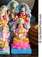 Goddess Laxmi - An idol of goddess laxmi along with other...