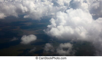 Through the clouds - Reducing aircraft, thick clouds, aerial...