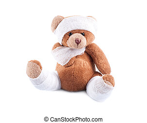 Sick teddy bear wrapped in bandages, isolated on white...