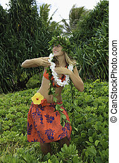 hawaiian hula danced by a teenage girl in hawaii