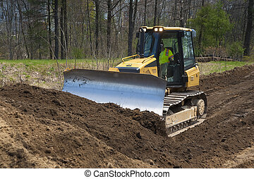Bulldozer pushing dirt on construction site