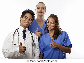 three medical students/interns/nurses giving a thumb's up.