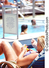 Cruise vacation. - Female relaxing on the deck of a cruise...
