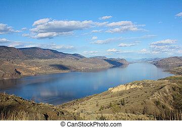 Lake - Blue sky reflection in lake inbetween mountains