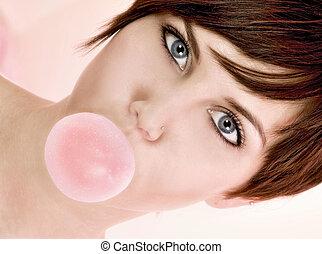 Bubble Gum - Young brunette blowing bubble.