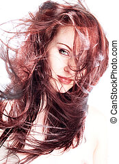 Hair - Red haired model in studio with hair blown around