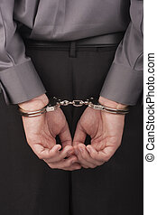 Arrested in handcuffs - I arrested his hands handcuffed...