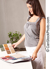 Interior Designer with Carpet Swatch - A female interior...