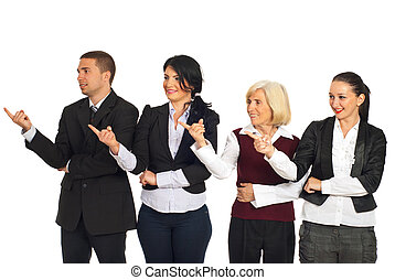 Four business people pointing in left part