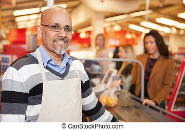 Supermarket Cashier Portrait - Portrait of a happy cashier...