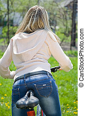 Outdoor young woman with bicycle - Outdoor shoot of young...