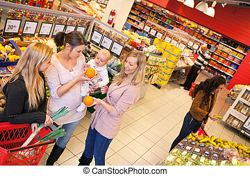 Mother and Friends in Grocery Store - High angle view of...