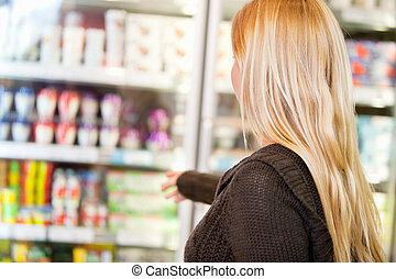 Faceless Woman in Supermarket - Close-up of woman reaching...