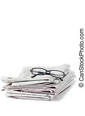 Newspapers and black glasses on a white a background