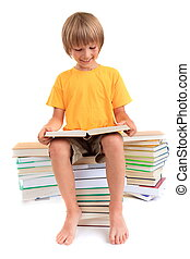 Happy boy reading books - A happy young boy studying and...