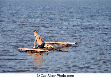 Young boy on raft in the water