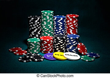 stacks of chips for poker with buttons of dealer, small...