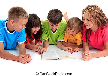 Children reading book - High angle view of five children and...