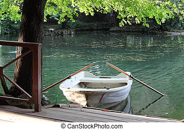 Row boat moored on lake