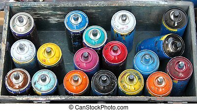 Color spray cans - Box with color spray cans used by an...