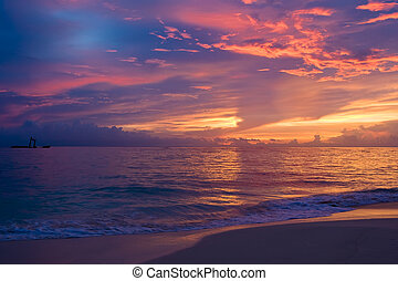 Yellow red pink blue sunset on the ocean in summer