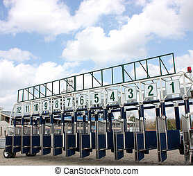 Start of the race. - Start gates for horse races.