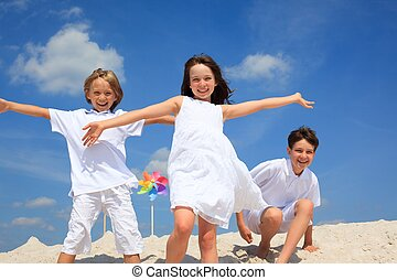 Children playing on beach - Happy children playing together...