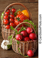 Harvest. - Two wicker baskets with fresh garden vegetables.