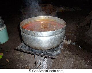 cooking stew - preparing food at home in Ghana