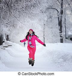 woman in winter park - woman run in winter park very happy