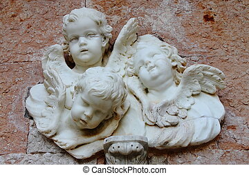 Angels - Basrelief from old building depicting three small...