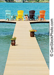 dock with colorful adirondack chair