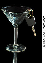 dont drink and drive concept with martini glass and car keys...