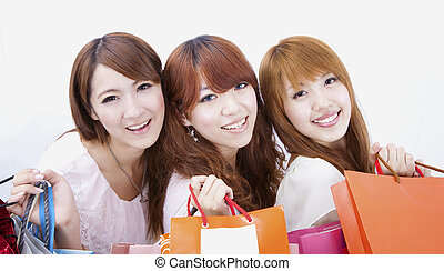 three happy shopping girl