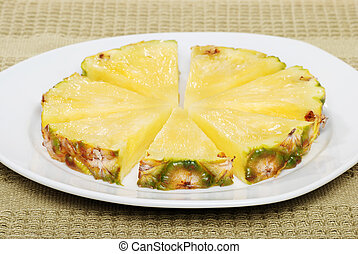 cut pineapple on a plate