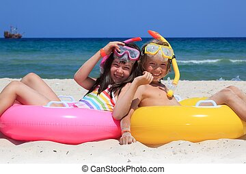 Kids on the beach - A pair of kids sitting on the beach