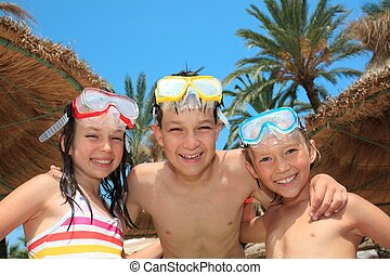 Kids with snorkel masks - Three kids with snorkel masks and...