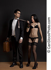Work and Pleasure - Sexy young woman grab the tie of the...
