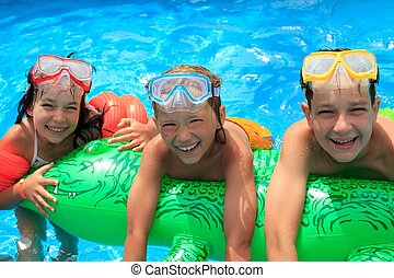 Children in swimming pool - Closeup of smiling young...