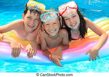 Happy kids in the pool - Happy children in the swimming...