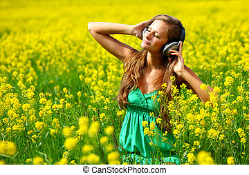 listening to music - Young woman with headphones listening...