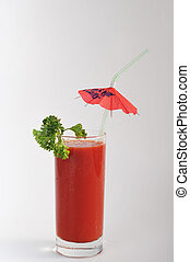 tomato juice in glass close up