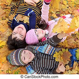 Children playing in Autumn - Portrait looking down on three...
