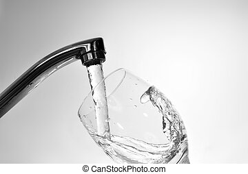 water from faucet - Filling glass with fresh water from...