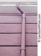 Rain gutter - Purple rain gutter on purple tiled wall