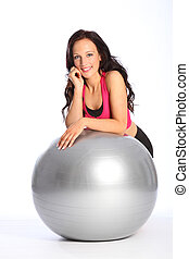 Glamorous young woman poses in gym fitness outfit