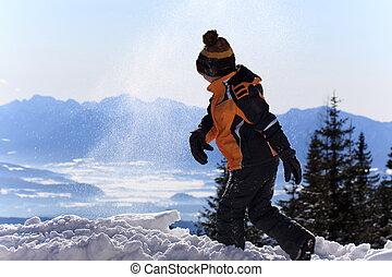 Happy boy on snowy mountain